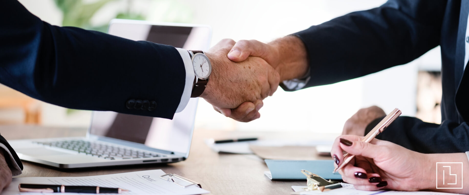 people shaking hands over a real estate deal - Beachworks LLC