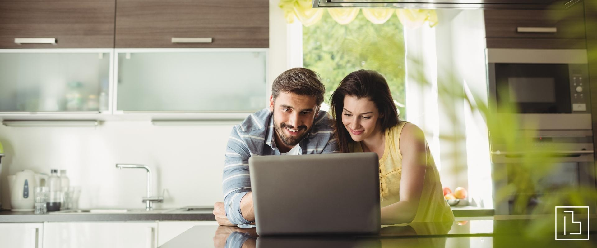 Two people looking at laptop in a kitchen - Beachworks LLC